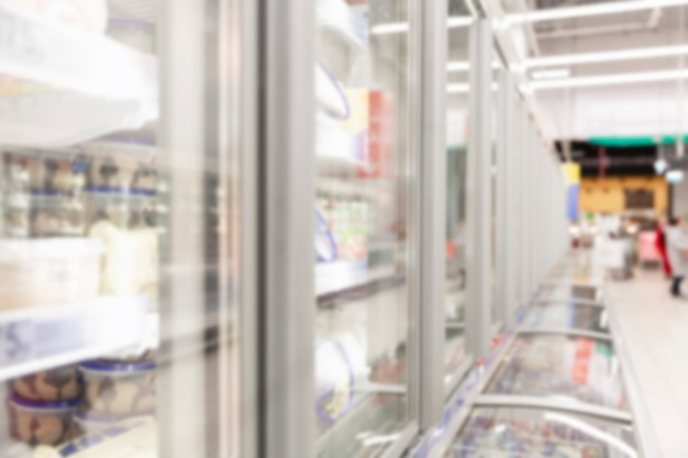 Glass showcase with frozen foods in the store Premium Photo
