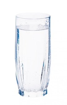 Glass of sparkling water with water drops on the surface of glass