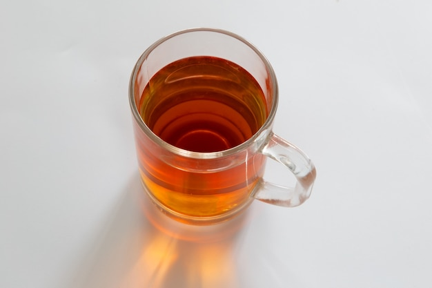 Glass of tea on white background