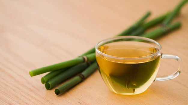 Glass of tea with bamboo