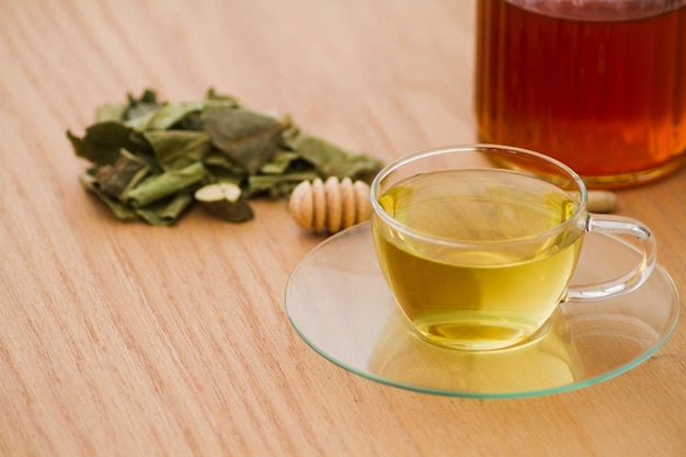 Glass of tea with leaves