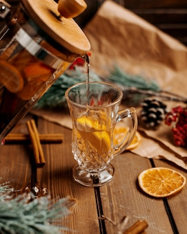 Glass of tea with lemon on the table