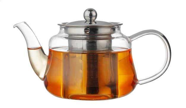 白で分離された紅茶とガラスのティーポット