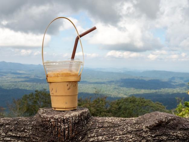 A glass of thai tea on a mountain in khao yai national park