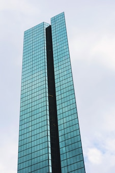 Glass tower with white clouds in city of boston