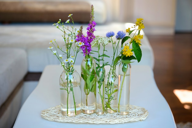 Glass vases with the flowers on a table