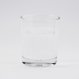 Glass of water on grey backdrop