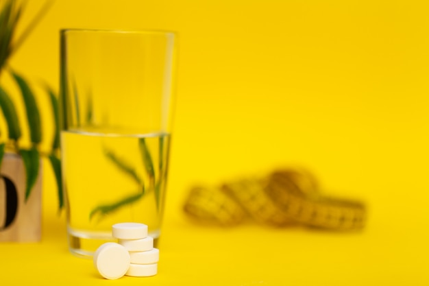 Glass of water and pill for weight loss