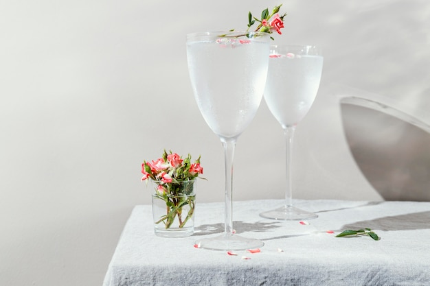 Glass of water with flower petals