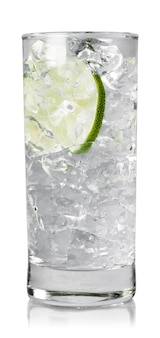 Glass of water with ice cubes and lime
