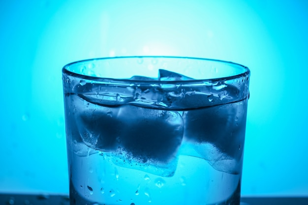 A glass of water with ice