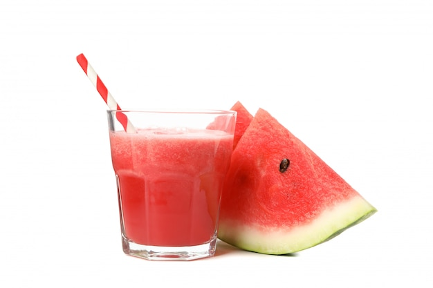 Glass of watermelon juice and slices isolated on white space