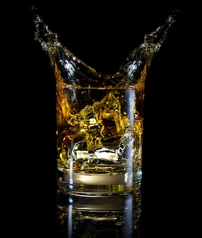 A glass of whiskey and splash