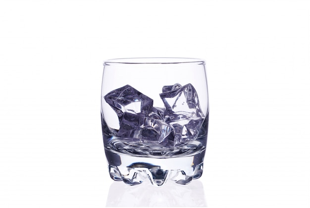 A glass of whiskey with ice cubes on a white background isolate.
