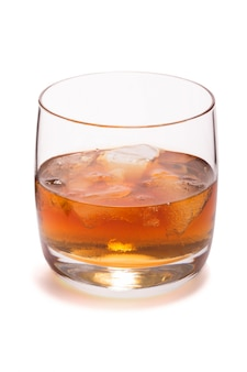 Glass of whiskey with ice isolated