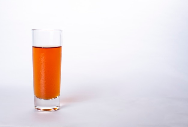 Glass of whisky and brandy isolated on a white background