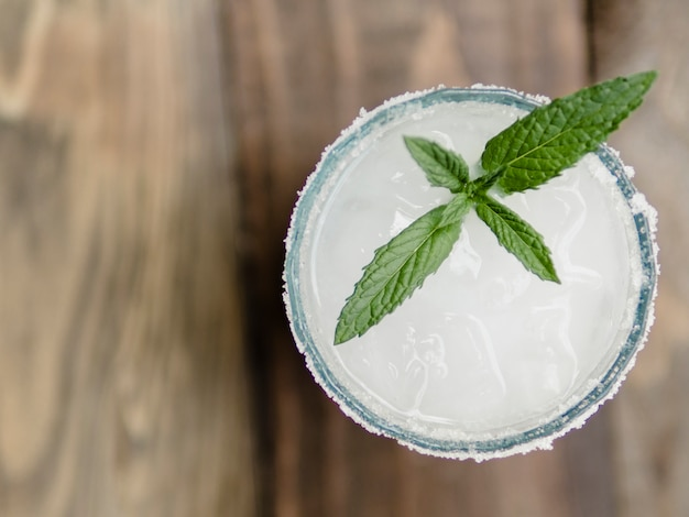 Glass of white cocktail with mint