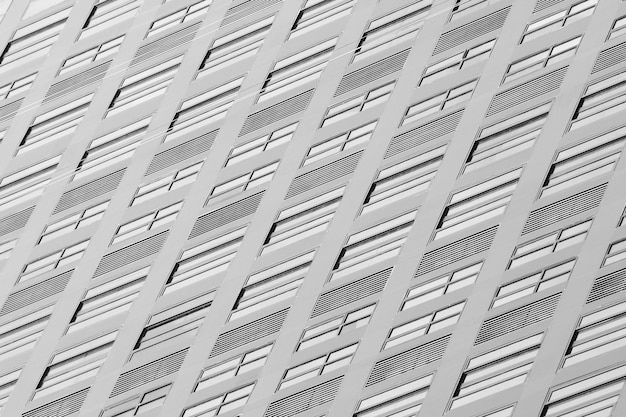 Glass window of contemporary skyscraper - monochrome