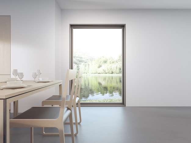 木製のテーブルとモダンな湖の家の椅子の近くのガラス窓。