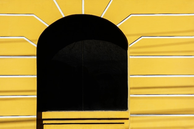 Glass window of yellow antique buildings