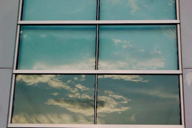 Glass windows reflect the shadow of the sky.