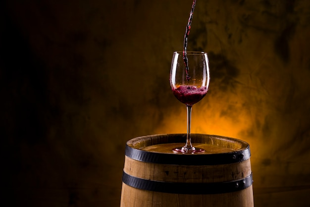 A glass of wine on a barrel