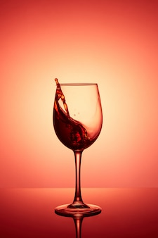 Glass of wine. red wine abstract splashing.