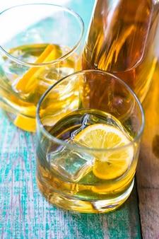 Glass of wiskey, lemon and ice