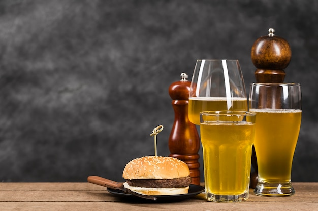 Glass with beer and hamburger