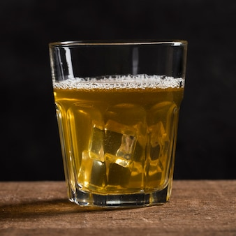 Glass with beer and ice cubes