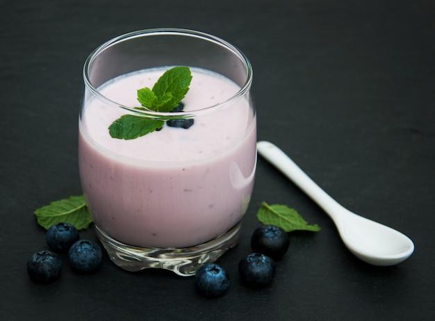Glass with blueberry yogurt