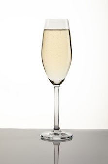 Glass with champagne on white
