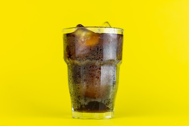 Glass with cold cola
