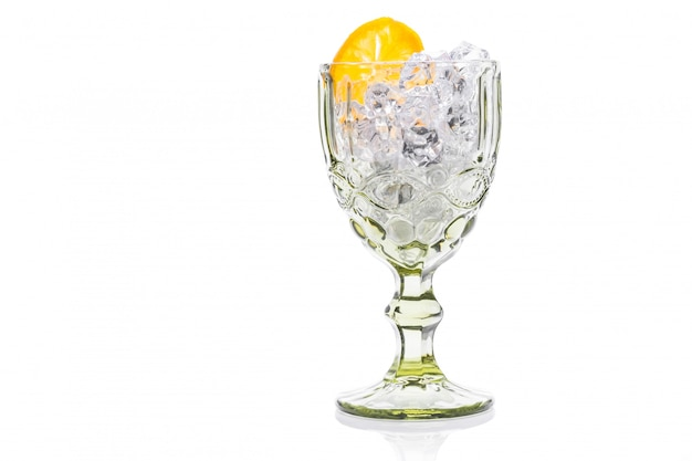 Glass with cold water with ice and lemon