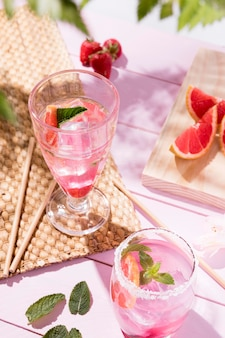 Glass with fresh fruits drinks on table