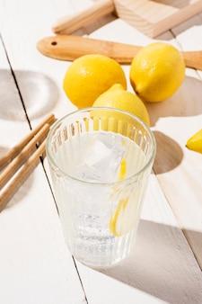 Glass with fresh lemonade on table