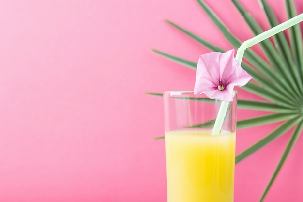 Glass with freshly squeezed pineapple citrus tropical fruit juice