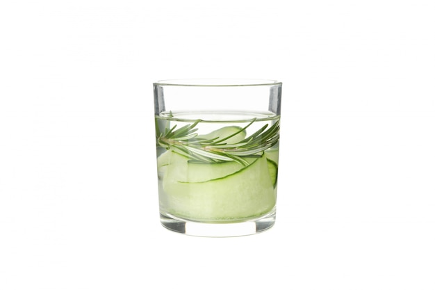 Glass with infused cucumber water isolated on white background