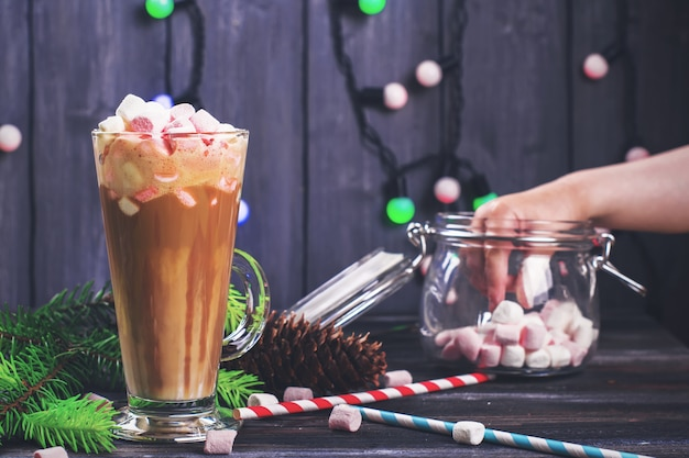 Glass with latte and marshmallows, x-mas concept.