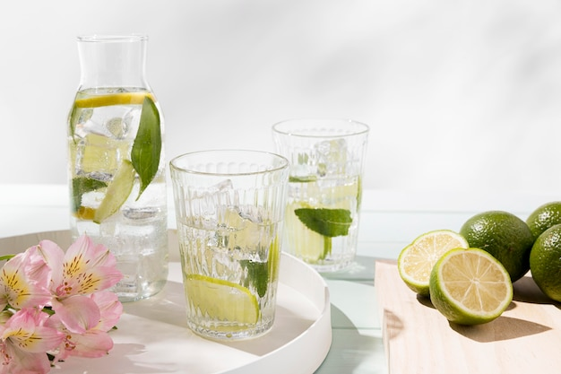Glass with lime drink on tray