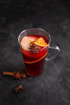 Glass with mulled wine and condiments