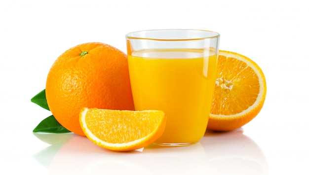 Glass with orange juice and fruits with green leaves isolated