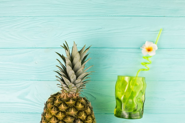 Glass with straw and pineapple