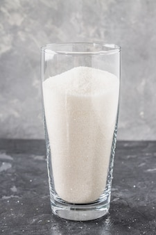 Glass with sugar sand is an unhealthy diet. the contents of sugar in sweet soda.