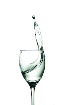 Glass with water isolated on a white background