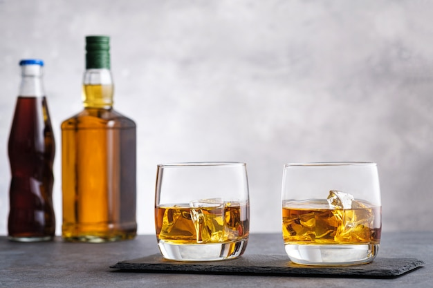 Glass with whiskey and ice cubes