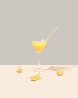 Стакан с желтым освежающим напитком и лимонами на пастельном и сером фоне минимальная концепция питания