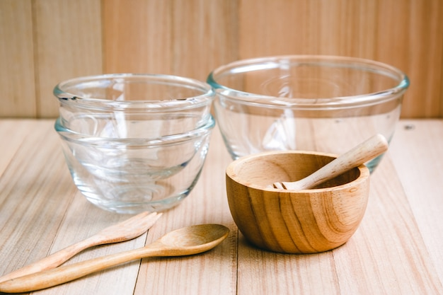 Glass and wooden bowl and kitchen utensils