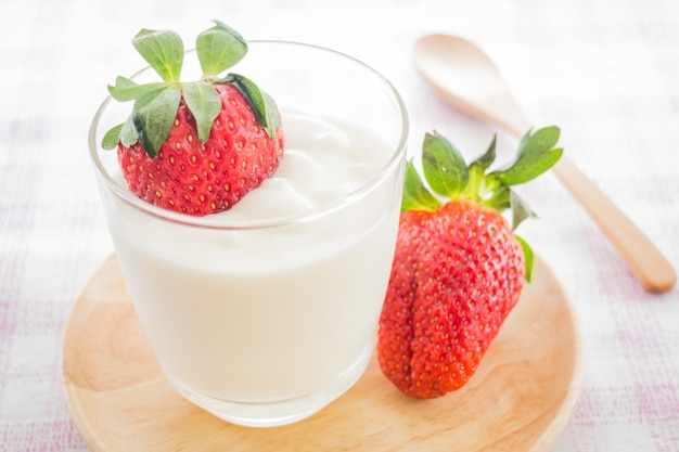 Glass of yogurt with fresh strawberry