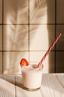 Glass of yogurt on wooden table